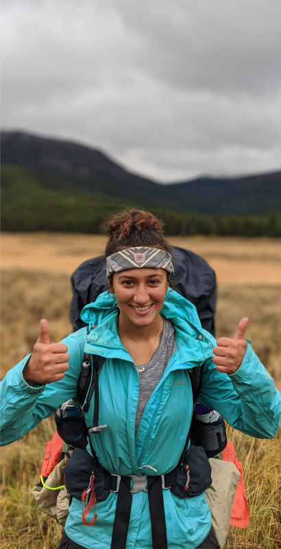 Traveler with backpack giving two thumbs up