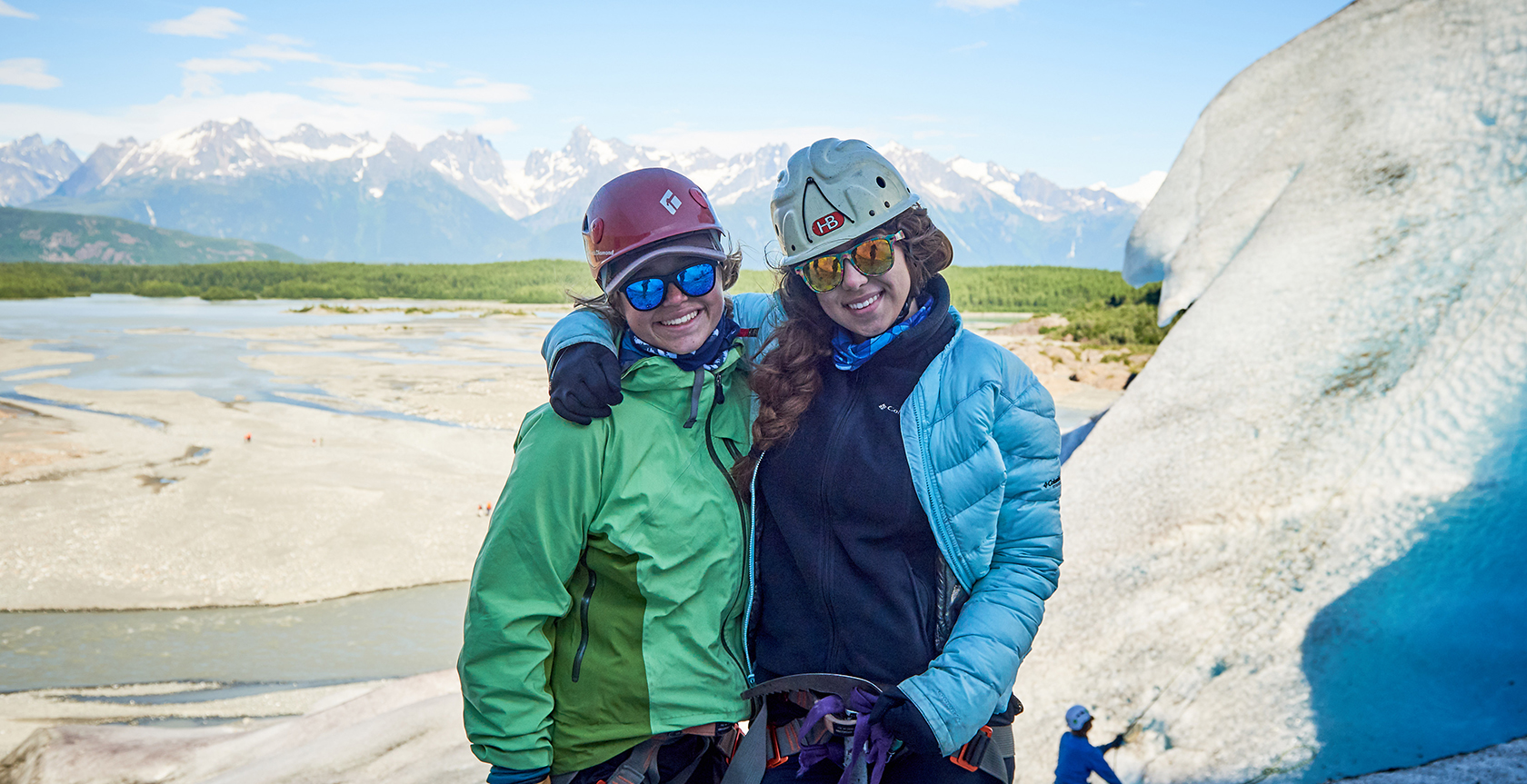 two female campers outside ice climbing